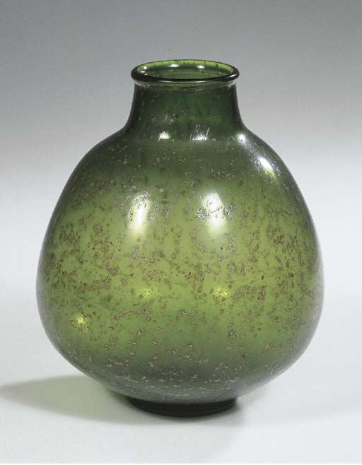 An Unica green glass vase