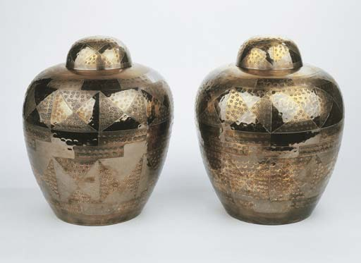 A pair of dinanderie vases and