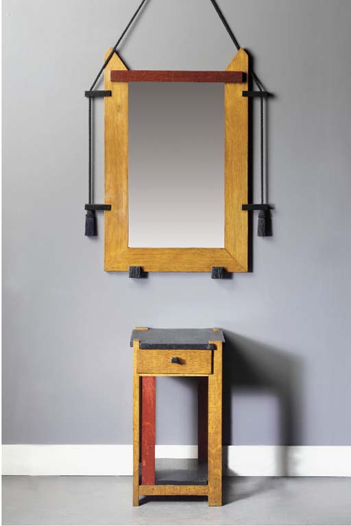 A stained oak hall mirror and