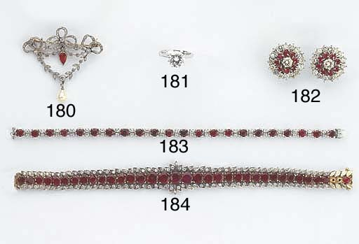 A WHITE GOLD DIAMOND AND RUBY