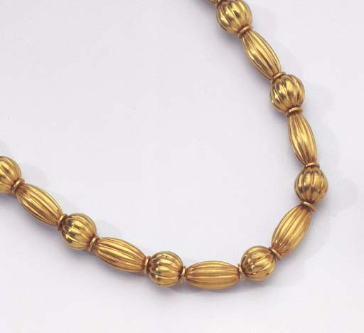 ZOLOTAS. A GOLD BEAD NECKLACE
