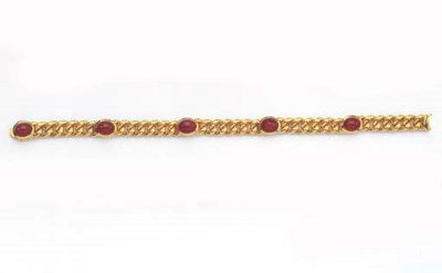 A GOLD AND RUBY BRACELET