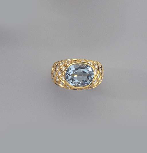A GOLD, DIAMOND AND BLUE TOPAZ