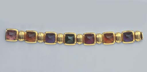 A GOLD AND GEM-SET BRACELET