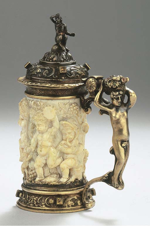 A small ivory silver-gilt moun