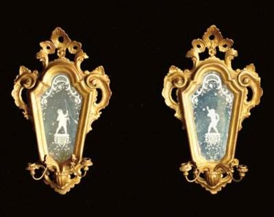 A pair of Venetian giltwood an