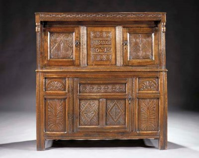 An English oak press cupboard