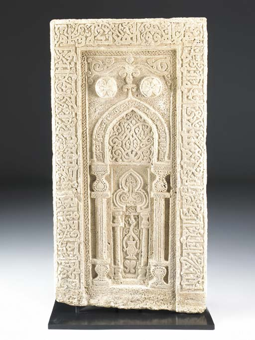 A LARGE CARVED WHITE MARBLE MI