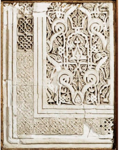 A MERINID CARVED STUCCO PANEL