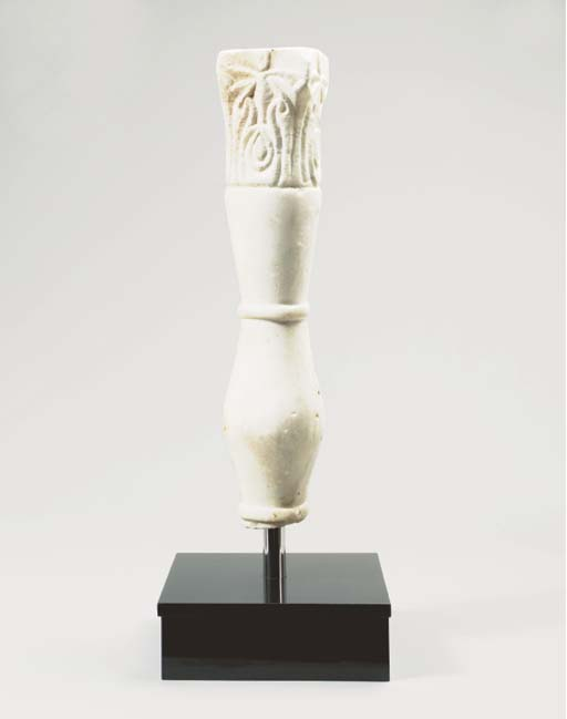A CARVED WHITE MARBLE COLUMN