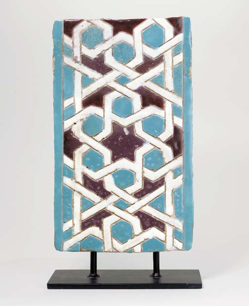 AN INCISED TURQUOISE, WHITE AN