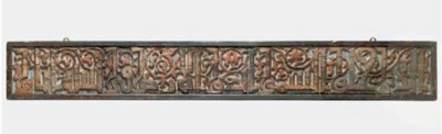 A CARVED POLYCHROME CALLIGRAPH