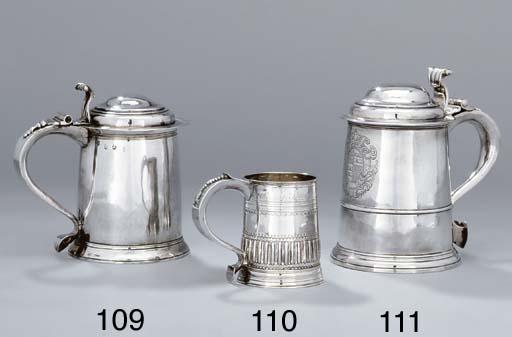 A Queen Anne silver tankard