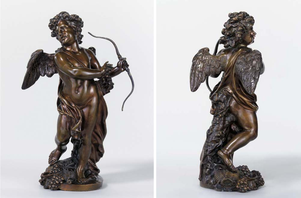A BRONZE FIGURE OF CUPID
