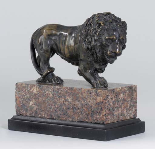 A BRONZE MODEL OF A PACING LION