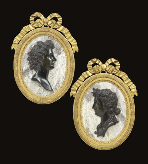 A PAIR OF LOUIS XIV PATINATED BRONZE MEDALLIONS