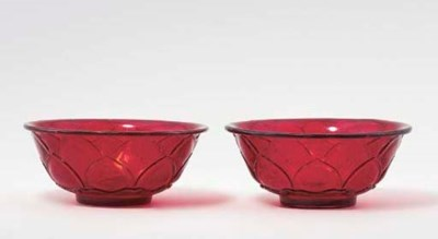 A FINE PAIR OF CARVED RED GLAS