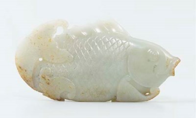 A WHITE JADE CARVING OF A FISH