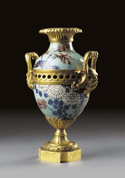 A LATE LOUIS XV ORMOLU AND CHI