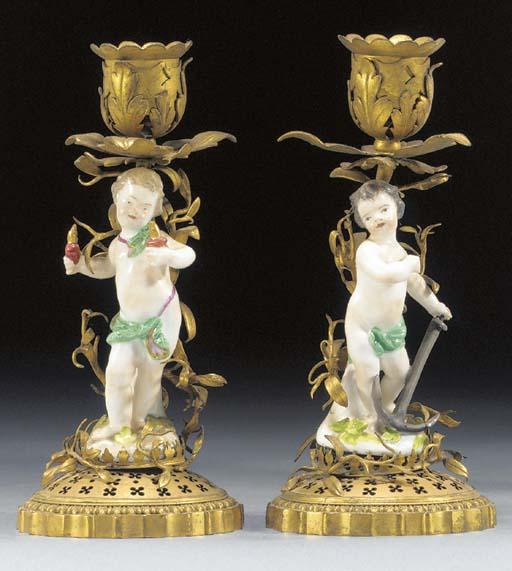 A pair of Meissen ormolu-mounted candlesticks