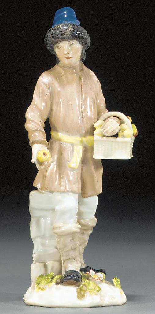 A Meissen figure of a fruit-ve