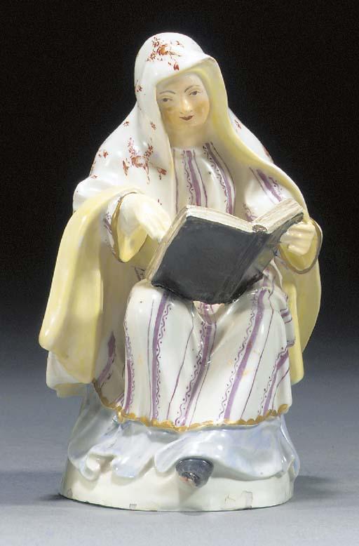 A Höchst figure of a nun readi