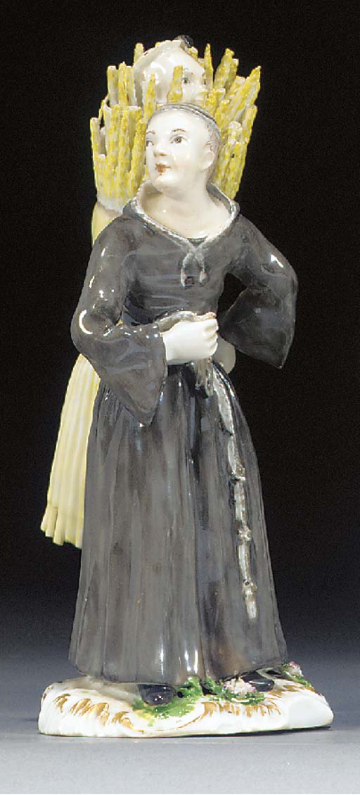 A German porcelain figure of T