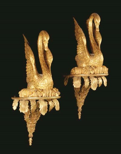 A PAIR OF GILTWOOD SWANS AND A