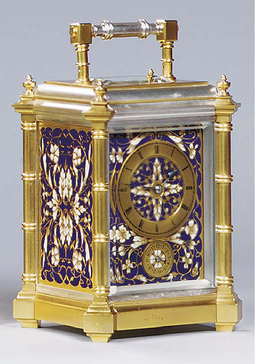A French gilt and silvered brass and champlevé enamel mounted grande sonnerie carriage clock with alarm