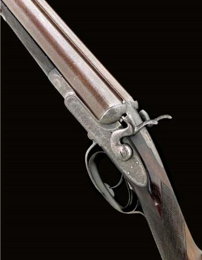 A 12-BORE SIDELOCK HAMMER GUN