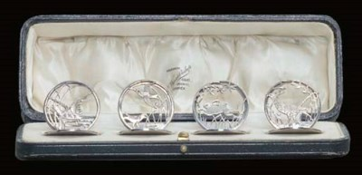 A CASED SET OF FOUR SILVER MEN