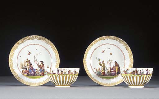 A pair of Meissen chinoiserie gilt gadrooned teabowls and saucers