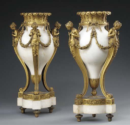 A pair of Napoleon III ormolu-mounted white marble urns