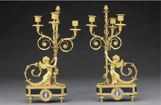 A pair of Napoleon III gilt-br