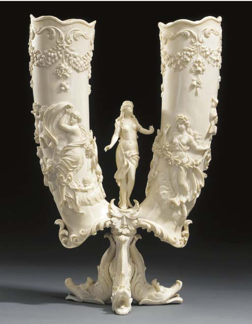 A French carved ivory double c