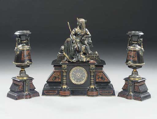 A Napoleon III Egyptian-revival marble patinated and gilt-bronze clock garniture