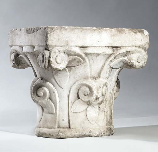 A CARVED ANDALUSIAN MARBLE CAP