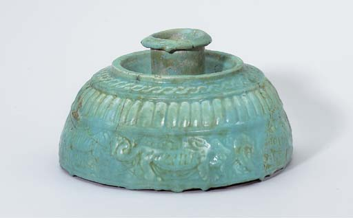 A MOULDED TURQUOISE GLAZED POT
