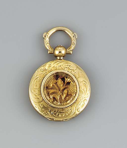 A citrine-set gold locket vina