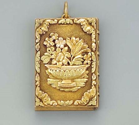A vari-coloured gold pendant v