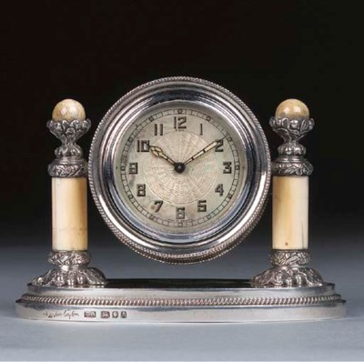 A Silver and Ivory Desk Clock