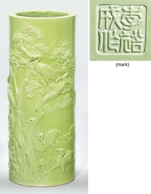 A LIME-GREEN-GLAZED CARVED CYL