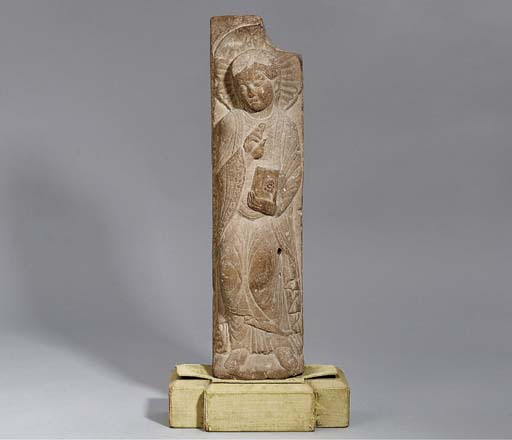 A CARVED STONE FIGURE OF A MAL