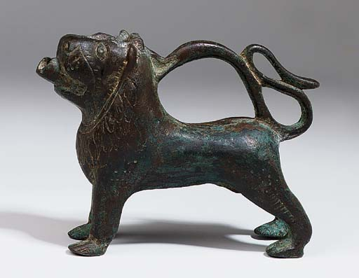 A BRONZE AQUAMANILE IN THE FOR