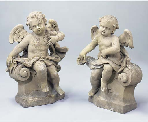 A PAIR OF CARVED STONE PUTTI