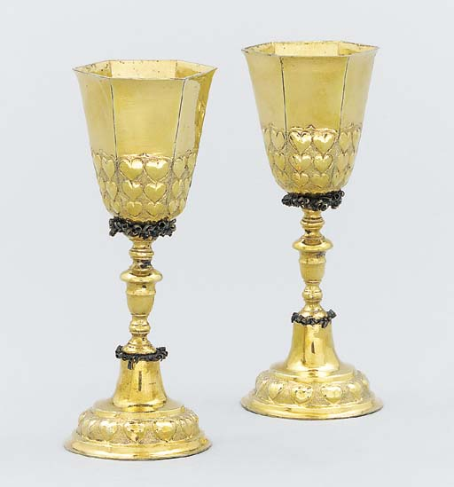 A pair of silver-gilt cups