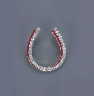 A DIAMOND AND RUBY HORSESHOE B