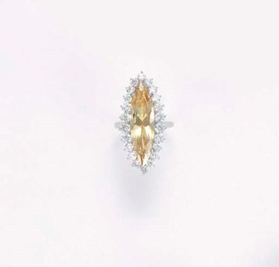 A COLOURED DIAMOND CLUSTER RIN