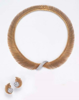 A DIAMOND-SET NECKLACE AND EAR