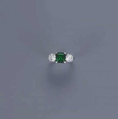 AN EMERALD AND DIAMOND THREE-S